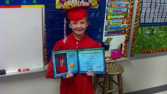 Ethan with his certificate